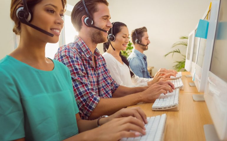 Business team working together with call center software